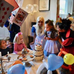 Alice In wonderland with the birthday girl blowing out her candles