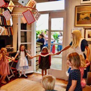 Alice In wonderland with children holding hands