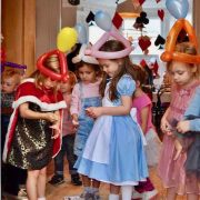 Children's dressed as Alice In Wonderland wearing Balloon Hats