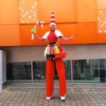 Amazing Miss Santa Stilt Walker with Balloon Modelling