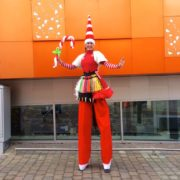 Amazing Miss Santa Stilt Walker with Balloon Modelling
