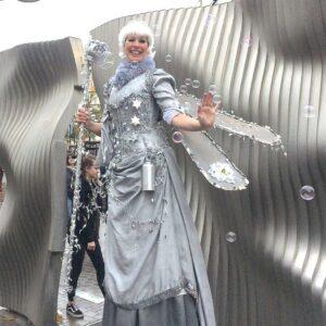 Bubble Blowing Silver Fairy on Stilts