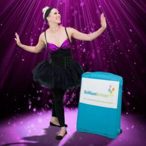 Ballerina dressed in a Black Tutu with a Brilliant Birthdays Suitcase