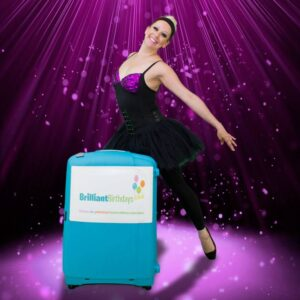 Ballerina with a Brilliant Birthdays Suitcase holding a Ballet Pose