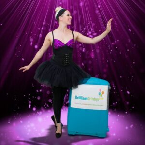 Ballerina Entertainer with a Brilliant Birthdays Suitcase in a Ballet Position