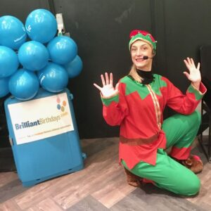 Eddie The Elf Christmas Party Entertainer on her Knee
