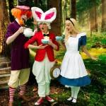 Alice, The Mad Hatter and the white Rabbit all enjoying tea