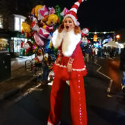 Miss Santa On Stilts with Lights