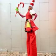 Miss Santa On Stilts with Balloons Modelling