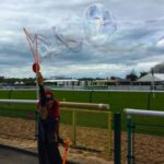 Batwoman Lookalike Bubble Performer