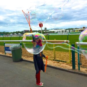 Batwoman Lookalike Bubble Performer